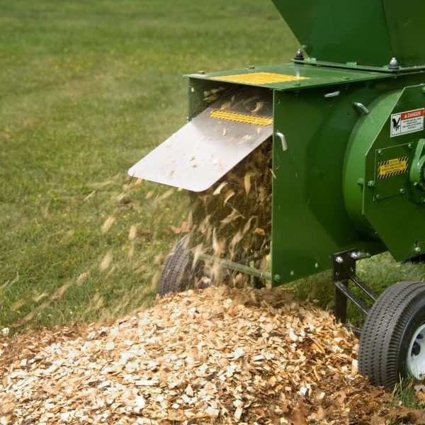 wood chips coming out of Mighty Mac Hammermill Shredder-Chipper
