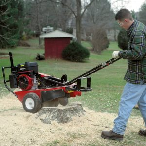 Merry Commercial Stump Cutter being used to cut a stump