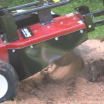 stump cutter at work - stump being grinded by the Merry Commercial machine