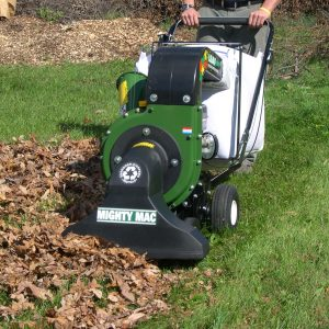 Mighty Mac Self-Propelled Vacuums being used to pick up a thick pile of leaves