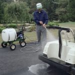 Mighty Mac 22 Gallon Sprayer cleaning a golf cart
