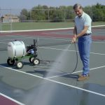 Mighty Mac 22 Gallon Sprayer being used on a tennis court