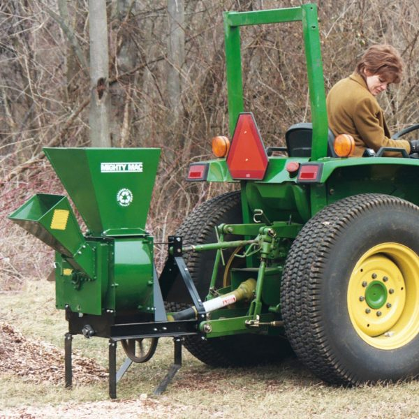 Mighty Mac Hammermill Shredder Chipper TPH123 hitched to a tractor