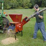 Man using Mighty Mac Hammermill Shredder Chipper TPH185 to grind tree