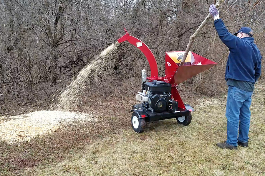 Man using Merry Commerical Wood Chipper